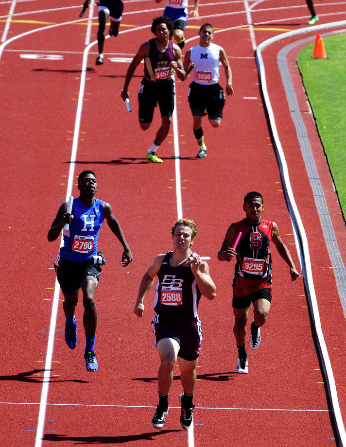 East Bernard's Ty Slanina leads the 2A Boys 4x400 Meter Relay to the finish line during the UIL High School State Track Meet at Mike A. Myers Stadium Saturday, May 11, 2013, in Austin. Photo: Cody Duty, Houston Chronicle / © 2013 Houston Chronicle
