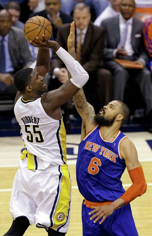 Indiana Pacers center Roy Hibbert, left, hits a shot over New York Knicks center Tyson Chandler during the second half of Game 3 of the Eastern Conference semifinal NBA basketball playoff series in Indianapolis, Saturday, May 11, 2013.  (AP Photo/Michael Conroy) Photo: Michael Conroy