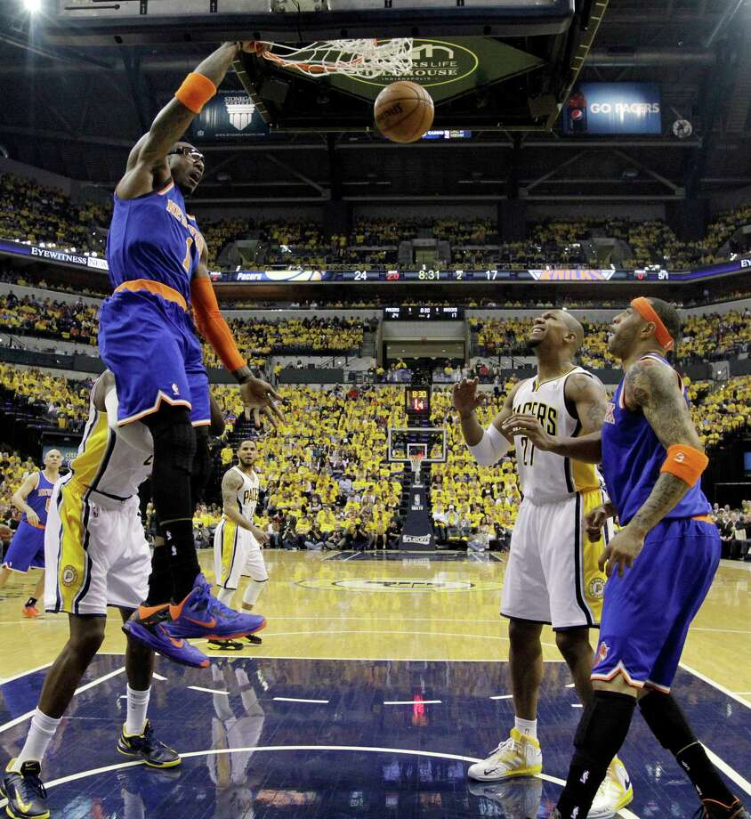 New York Knicks' Amar'e Stoudemire, left, dunks during the first half of Game 3 of an Eastern Conference semifinal NBA basketball playoff series against the Indiana Pacers in Saturday, May 11, 2013, in Indianapolis. (AP Photo/Darron Cummings) Photo: Darron Cummings