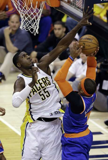 Pacers center Roy Hibbert fouls Knicks forward Carmelo Anthony during the first half of Game 3. Hibbert had 24 points and 12 boards. Photo: Michael Conroy / Associated Press