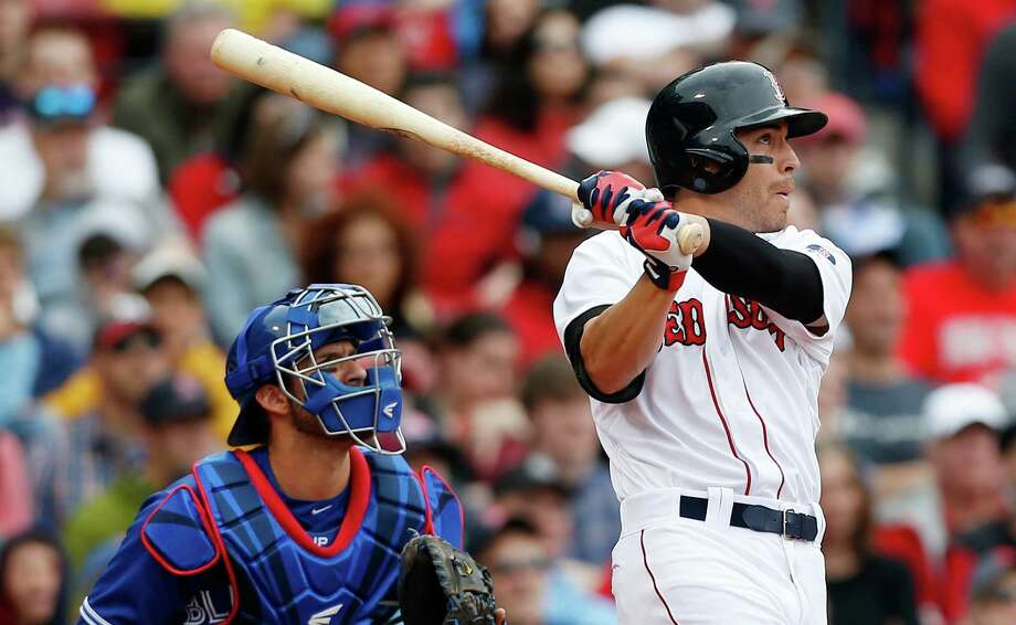 Boston Red Sox's Jacoby Ellsbury, right, hits a one-run triple in front of Toronto Blue Jays' J.P. Arencibia in the eighth inning of a baseball game in Boston, Saturday, May 11, 2013. (AP Photo/Michael Dwyer) Photo: Michael Dwyer