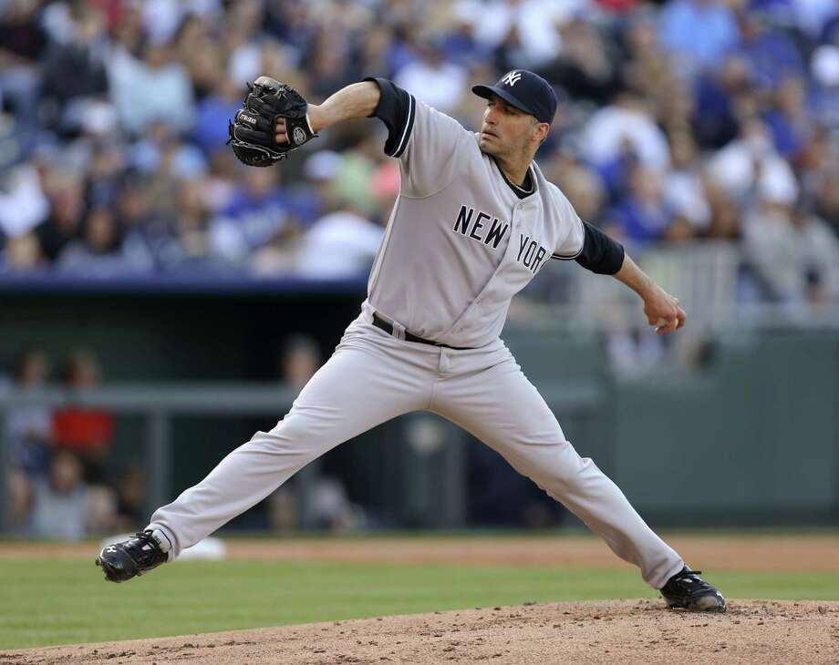KANSAS CITY, MO - MAY 11:  Andy Pettitte #46 of the New York Yankees pitches against the Kansas City Royals in the first inning at Kauffman Stadium on May 11, 2013 in Kansas City, Missouri. (Photo by Ed Zurga/Getty Images) Photo: Ed Zurga
