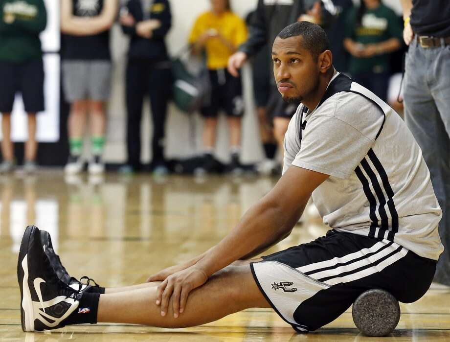 The Spurs' Boris Diaw stretches during practice Saturday, May 11, 2013, at the War Memorial Gymnasium on the University of San Francisco campus in San Francisco, Calif.