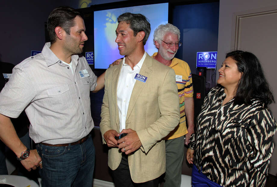 Ron Nirenberg is congratulated by supporter Francisco Gonima as his dad Ken Nirenberg and wife Erika Prosper enjoy the moment at his election night party at Franco's  on May 11, 2013. Photo: TOM REEL
