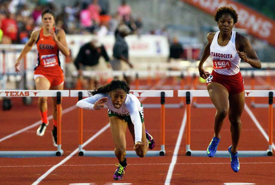 Spring's Alaysh'A Johnson falls at the finish line, but the spill did not stop her from defending her state Class 5A title in the 300-meter hurdles. Earlier in the day, she won the 100-meter hurdles. Photo: Cody Duty, Staff / © 2013 Houston Chronicle