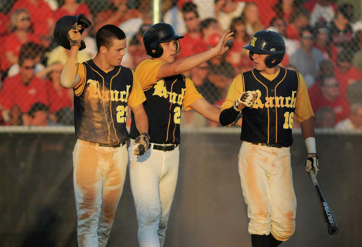 Cypress Ranch's Cameron Guerra, Kyle Warren and Austin Strickland celebrate as the Mustangs score three runs in the fourth inning to take a five-run lead.