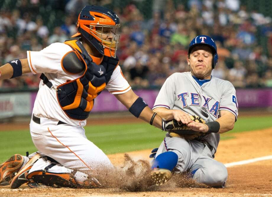 May 11: Rangers 8, Astros 7Rangers second baseman Ian Kinsler is out at home as Astros catcher Carlos Corporan applies the tag. Photo: Smiley N. Pool, Houston Chronicle