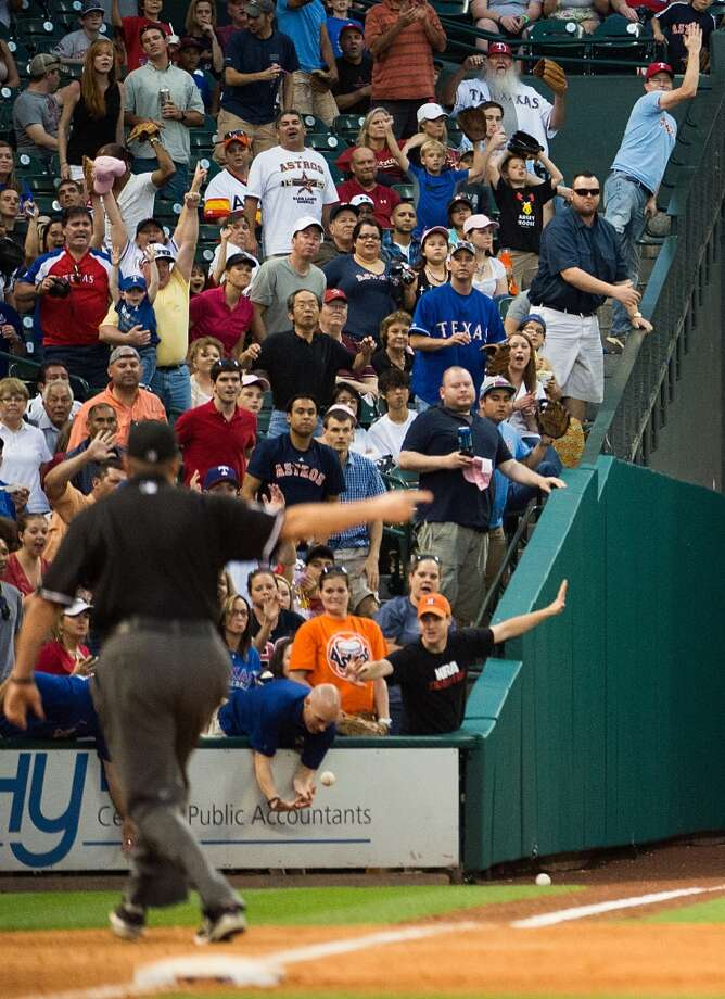 A fan interferes with a hit down the left field line by  David Murphy of the Rangers, resulting in ground-rule double, during the sixth inning.