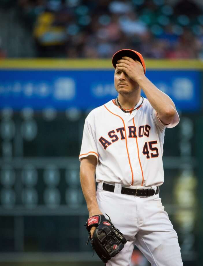 Astros starting pitcher Erik Bedard wipes his forehead after issuing a walk to load the bases during the fifth inning. Photo: Smiley N. Pool, Houston Chronicle