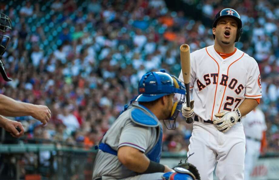 Astros second baseman Jose Altuve reacts after being called out on strikes during the fourth inning .