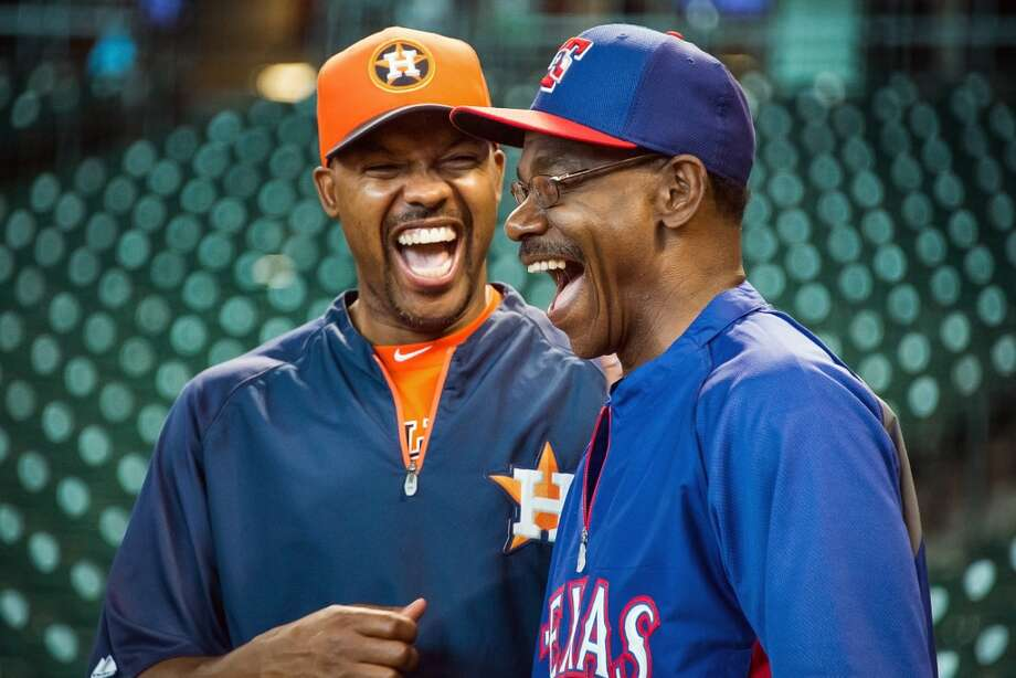 Astros manager Bo Porter, right, laughs with Rangers manager Ron Washington during batting practice.