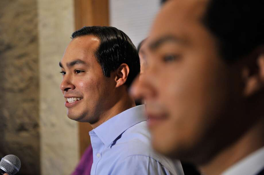 Mayor Julian Castro speaks to supporters Saturday evening after his primary election win flanked by his brother, Congressman Joaquin Castro.