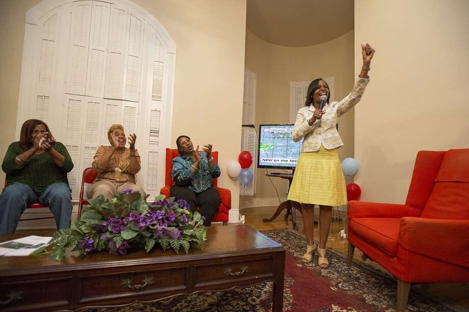District 2 Councilwoman Ivy Taylor, right, gives a victory speech on election night at 328 N. Pine Street on Saturday, May 11, 2013.
