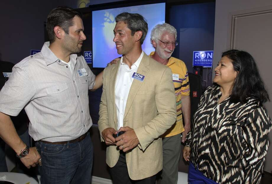 Ron Nirenberg is congratulated by supporter Francisco Gonima as his dad Ken Nirenberg and wife Erika Prosper enjoy the moment at his election night party at Franco's  on May 11, 2013.
