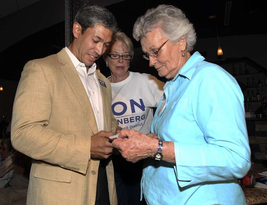 Ron Nirenberg looks at early results with supporters Betty Sutherland (right) and Bonnie Conner at his election night party  on May 11, 2013.