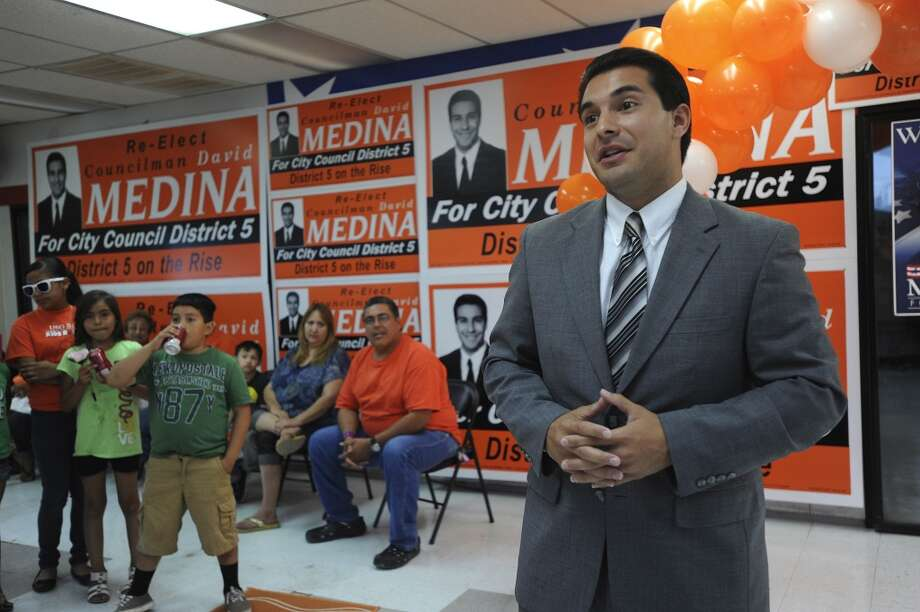 Incumbent District 5 Councilman David Medina speaks with supporters at his campaign headquarters on Saturday evening, May 11, 2013.