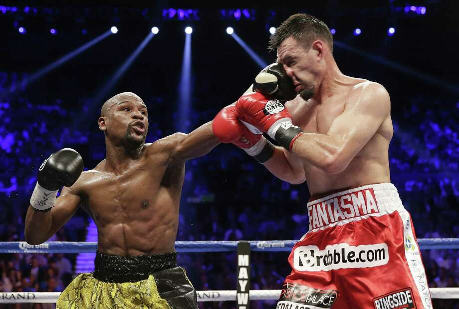Floyd Mayweather Jr., landing a left jab against Robert Guerrero last weekend, connected on 60 percent of his power shots and 41 percent of his punches overall in the bout. Photo: Isaac Brekken / Associated Press