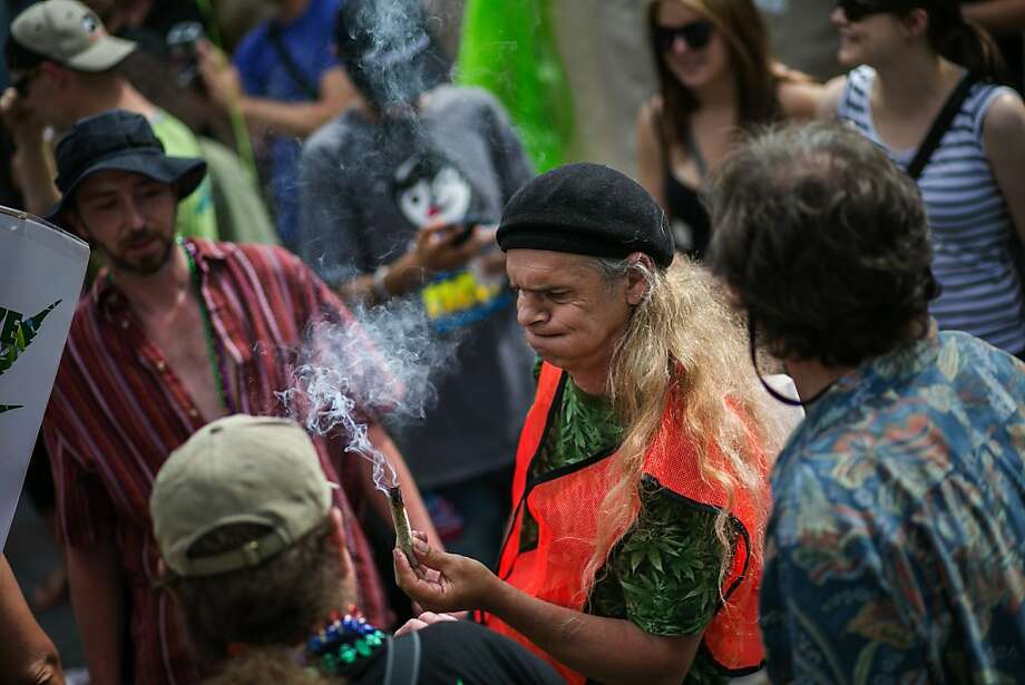 "John ""The Freak"" takes smoke on a cigar-sized marijuana blunt, after the Cannabis Freedom March, which started from Volunteer Park, made its way to a rally Westlake Park in Seattle, on Saturday, May 11, 2013.  Photo: Marcus Yam, Associated Press"