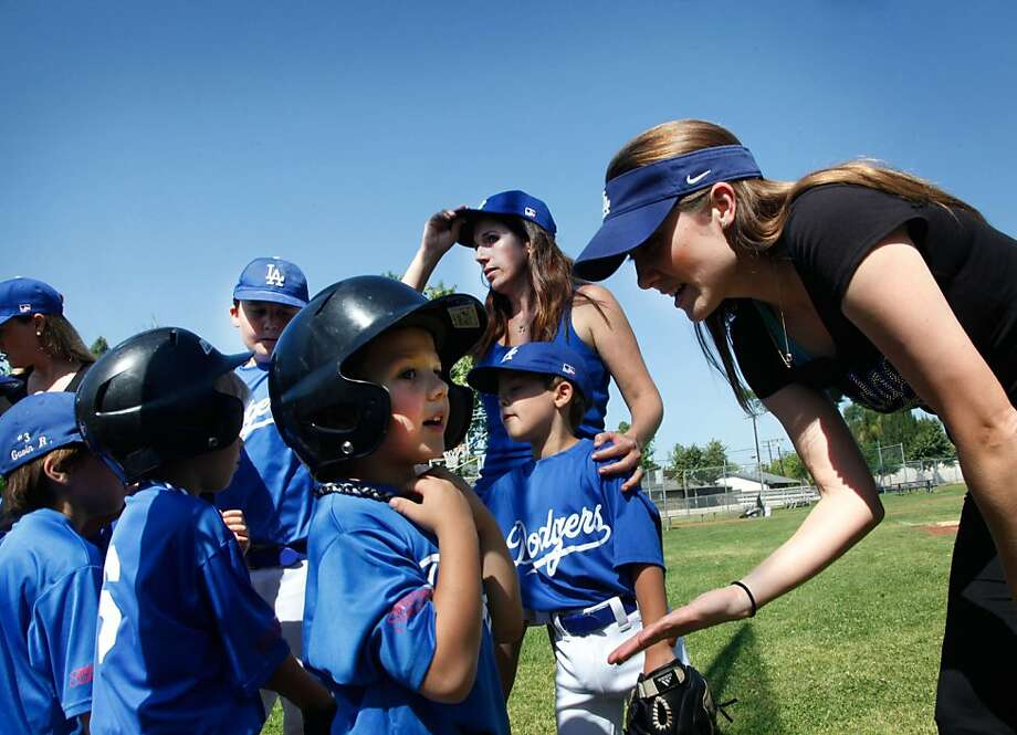 Mom coaches Claudia Chiovare and Jen Maljian, right, speak to their Little League baseball team following a game in Arcadia, California, on Saturday, May 11, 2013.  Photo: Barbara Davidson, McClatchy-Tribune News Service