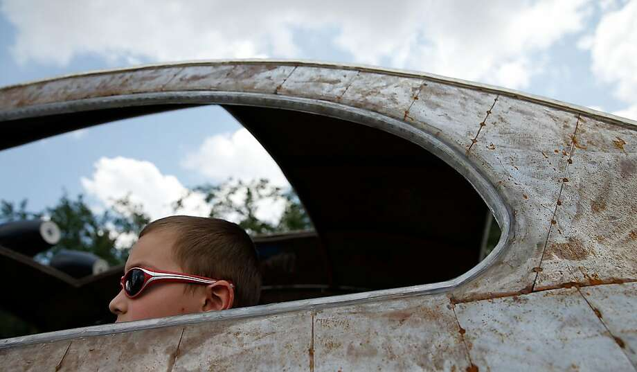 A parade goer sits in an art car on Allen Parkway during the 26th Annual Houston Art Car Parade on May 11, 2013 in Houston, Texas.  Photo: Scott Halleran, Getty Images