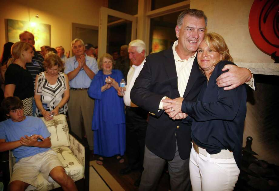 Victorious Dallas City Council District 13 candidate Jennifer Staubach Gates, the daughter of former Dallas Cowboys quarterback Roger Staubach, receives a hug from Dallas mayor Mike Rawlings after her acceptance speech to friends and supporters at her home Saturday night.