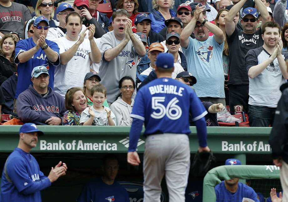 Toronto fans in Boston cheer as Mark Buehrle leaves after allowing one run in seven innings.