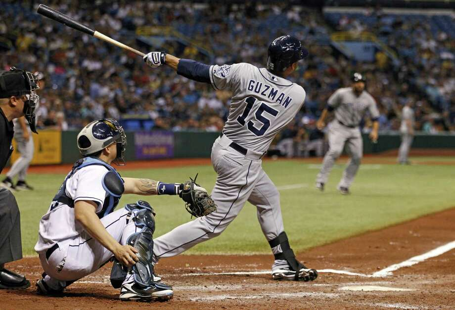 The Padres' Jesus Guzman hits a pinch-hit grand slam, but Tampa Bay rallied for an 8-7 victory.