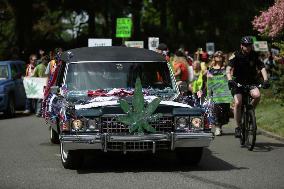 A hearse leads the way as a symbol of the death of prohibition during the Cannabis Freedom March. Marchers were demanding more freedom for pot smokers and growers and an end to prohibition at a federal level.  Photo: JOSHUA TRUJILLO, SEATTLEPI.COM / SEATTLEPI.COM