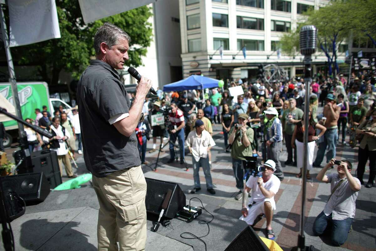 Jim Pugel, who will soon be interim Seattle Police Chief, addresses the crowd at Westlake Park during the Cannabis Freedom March. Pugel said he was not there to endorse or condemn marijuana use. He told participants to follow the rules set up under Initiative 502.