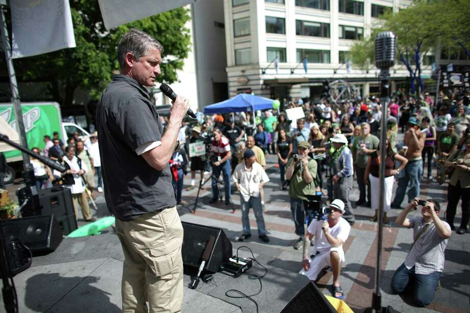 "Jim Pugel, who will soon be interim Seattle Police Chief, addresses the crowd at Westlake Park during the Cannabis Freedom March. Pugel said he was not there to endorse or condemn marijuana use. He told participants to follow the rules set up under Initiative 502. ""Please respect your police officers and don't use it in front of them,"" he said. The marchers were also demanding more freedom for pot smokers and an end to prohibition at a federal level. Photo: JOSHUA TRUJILLO, SEATTLEPI.COM / SEATTLEPI.COM"