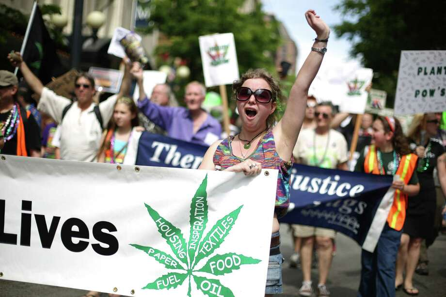 People march through downtown Seattle during the Cannabis Freedom March, celebrating the legalization of marijuana in Washington State. The marchers were also demanding more freedom for pot smokers and growers and an end to prohibition at a federal level. Photo: JOSHUA TRUJILLO, SEATTLEPI.COM / SEATTLEPI.COM