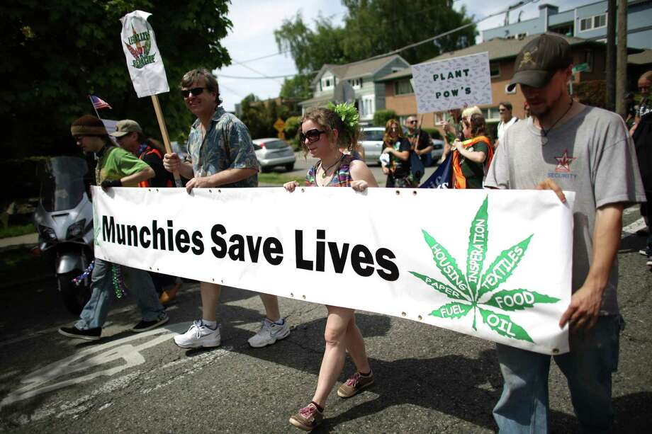 Participants march through Capitol Hill during the Cannabis Freedom March celebrating the legalization of marijuana in Washington State. The marchers were also demanding more freedom for pot smokers and growers and an end to prohibition at a federal level. Photo: JOSHUA TRUJILLO, SEATTLEPI.COM / SEATTLEPI.COM