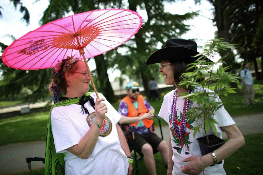 """A woman that goes by the name """"Nightmare Alabama"""" and DeMaris Strohm-Hughes wait to begin the march. Photo: JOSHUA TRUJILLO, SEATTLEPI.COM / SEATTLEPI.COM"""