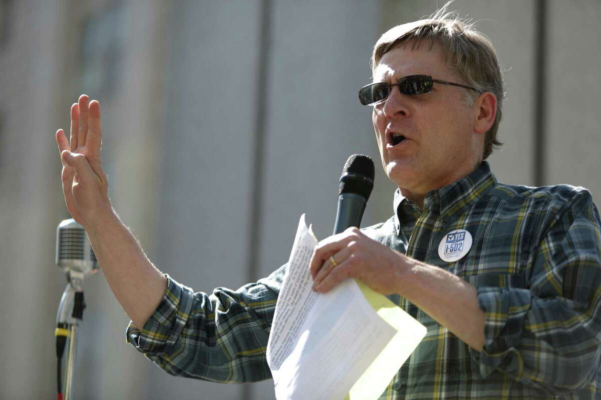 """Seattle City Attorney Pete Holmes, a supporter of the successful Initiative 502, speaks to the crowd during a """"prohibition funeral"""" celebrating the legalization of marijuana in Washington State. He is seeking a third term. The Seattle Police Officers Guild took out an $8,600 full page ad in the Seattle Times opposing Holmes' reelection. ."""