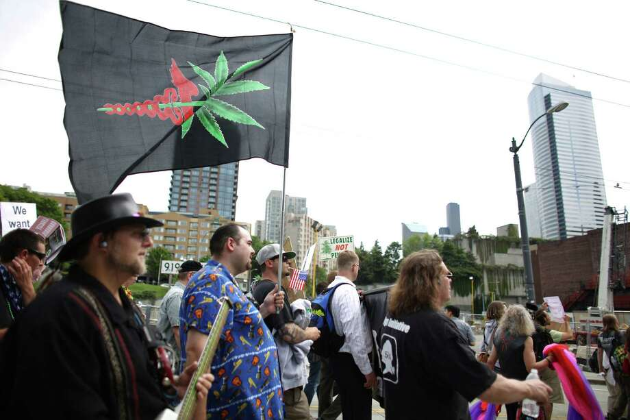 People march in downtown Seattle during the Cannabis Freedom March. Photo: JOSHUA TRUJILLO, SEATTLEPI.COM / SEATTLEPI.COM