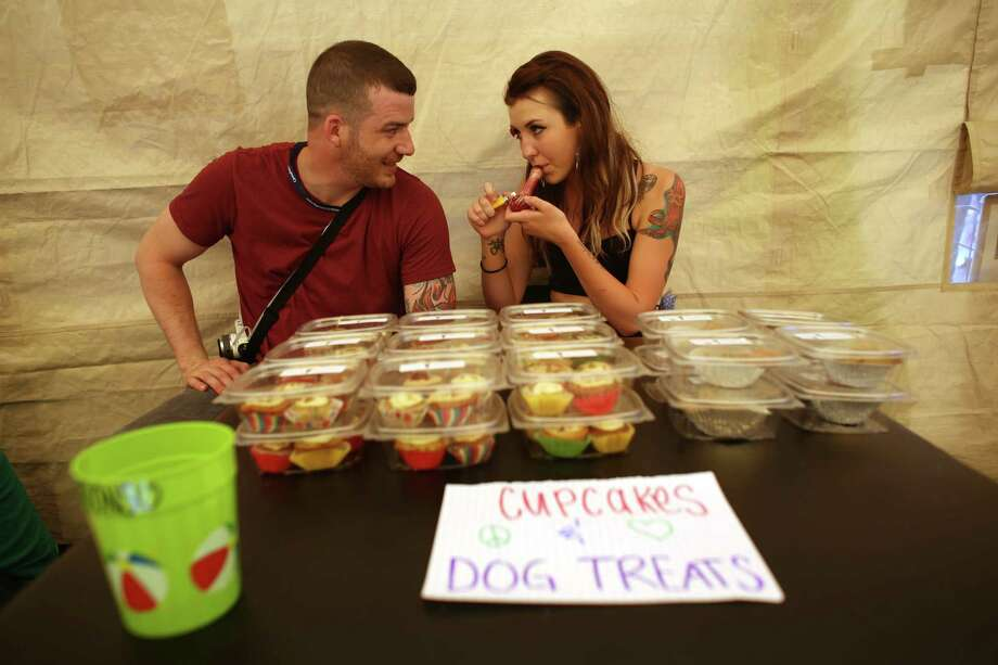 Johan Sanford and Mack Hoskin of Macs Medibles, sell pot cupcakes and pot infused dog treats in a smoking tent at Westlake Park. Photo: JOSHUA TRUJILLO, SEATTLEPI.COM / SEATTLEPI.COM