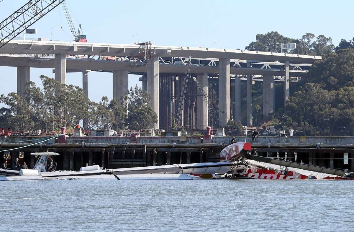 SAN FRANCISCO, CA - MAY 09: The wreckage of the Artemis Racing AC-72 catamaran is seen in the water at Hangar 3 at Treasure Island on May 9, 2013 in San Francisco, California. British sailor Andrew Simpson, a member of the Swedish America's Cup racing team died when he was submerged underwater for 10 minutes after the team's racing boat capsized on the San Francisco Bay. (Photo by Justin Sullivan/Getty Images)