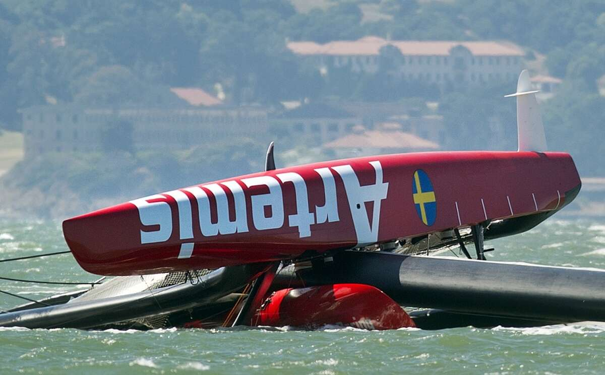 The Artemis Racing AC72 catamaran, an America's Cup entry from Sweden, lies capsized after flipping over during training in San Francisco Bay on Thursday, May 9, 2013, in San Francisco. Artemis Racing said Andrew