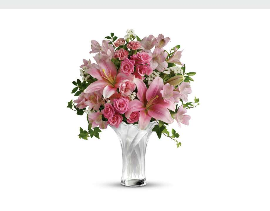 Whether with flowers, a meal or just fond wishes, remember mom on Sunday. Photo: Associated Press / TELEFLORA