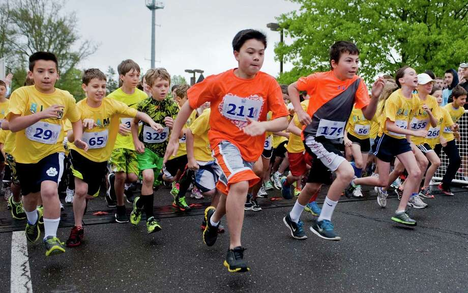 The start of the kids' 1 mile race at Yanity Gym in Ridgefield with 407 runners registered. Sunday, May 12, 2013 Photo: Scott Mullin