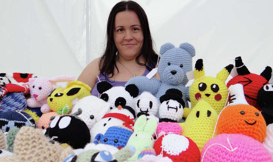 Sarah Sego with her crochet creatures Saturday at the Fairfield Woman's Club Arts & Crafts Fair on Town Hall Green. Photo: Mike Lauterborn / Fairfield Citizen contributed