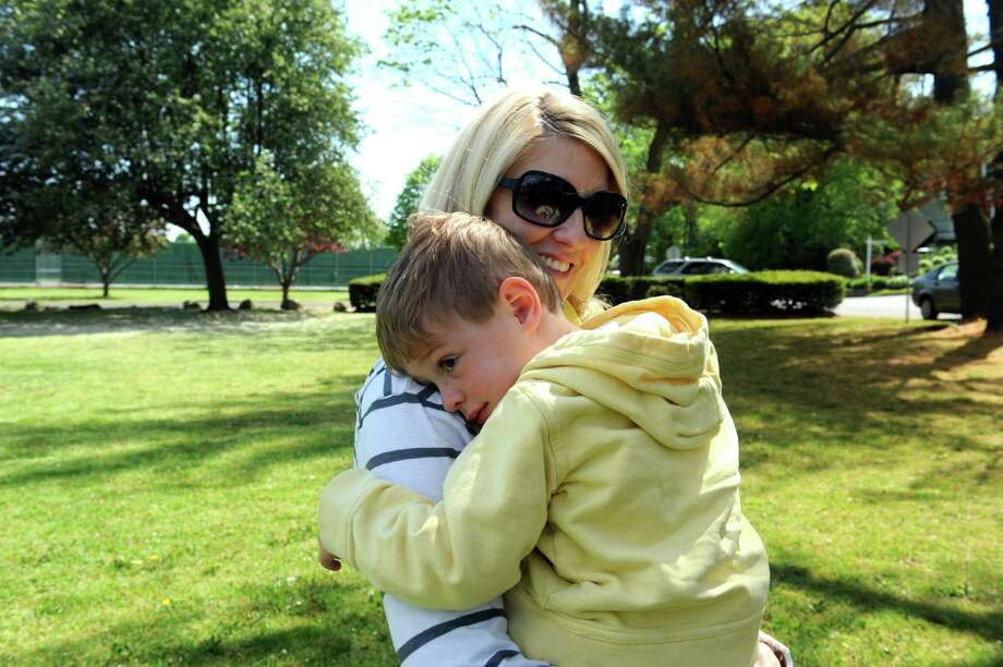 Janine Wiggin, of Somers, N.Y. holds her son, Kealin, 3, at Binney Park, in Old Greenwich, Sunday, May 12, 2013. Photo: Helen Neafsey / Greenwich Time