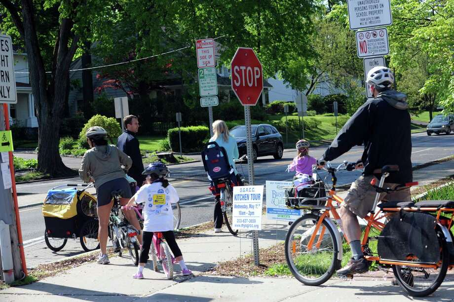 Families ride on Sound Beach Avenue at the Greenwich Safe Cycling's clelebration for Mother's day and National Bike Month, Sunday, May 12, 2013. The event starts at Old Greenwich School and goes around Greenwich Point. Photo: Helen Neafsey / Greenwich Time