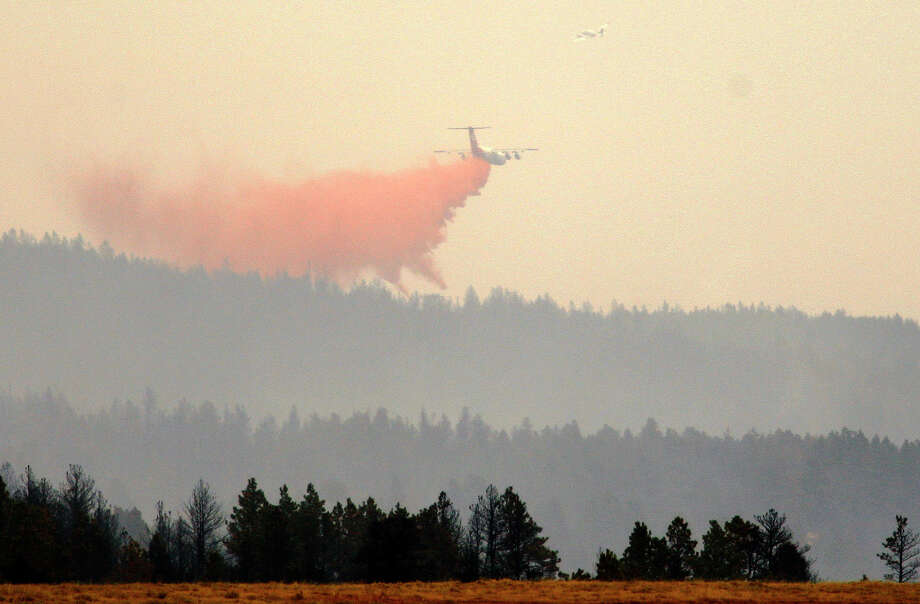 This Sept. 11, 2012 file photo shows a BAe3-146 air tanker dropping fire retardant near Casper, Wyo. The U.S. Forest Service on Monday, May 6, 2013 announced it has chosen contractors to povide a new generation of air tankers that are faster and deliver more payload than the current fleet. Among the types of aircraft is a BAE-146. Photo: AP