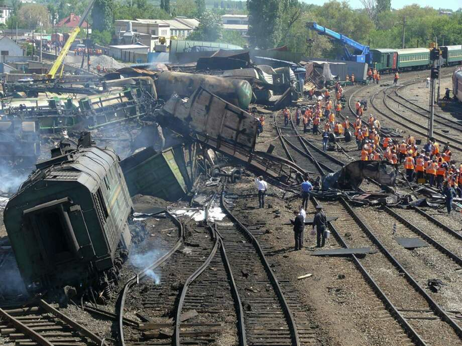 In this image taken from Ministry for Emergency Situations, Rostov-on-Don region branch website, a wrecked freight train with 50 tankers carrying fuel is derailed at Balaya Kalitva railway station, Thursday, May 9, 2013, in southern Russia, setting off a huge fire that left one person missing and 27 injured. The derailment occurred at around 2 a.m. at the Belaya Kalitva station in the Rostov region, Russia Today reported. About 2,700 people were evacuated from the area around the station. (AP Photo/Ministry for Emergency Situations, Rostov-on-Don region branch website)  Photo: AP