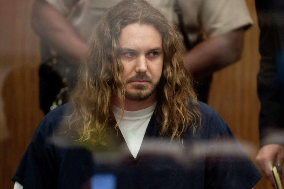 Tim Lambesis, 32, front man for the Christian-inspired heavy metal group As I Lay Dying, appears in Vista Superior Court in Vista, Calif. on Thursday, May 9, 2013. Labesis, who allegedly tried to hire a hit man to kill his wife, pleaded not guilty to a single count of solicitation for murder. He faces up to nine years in prison if convicted. Photo: AP