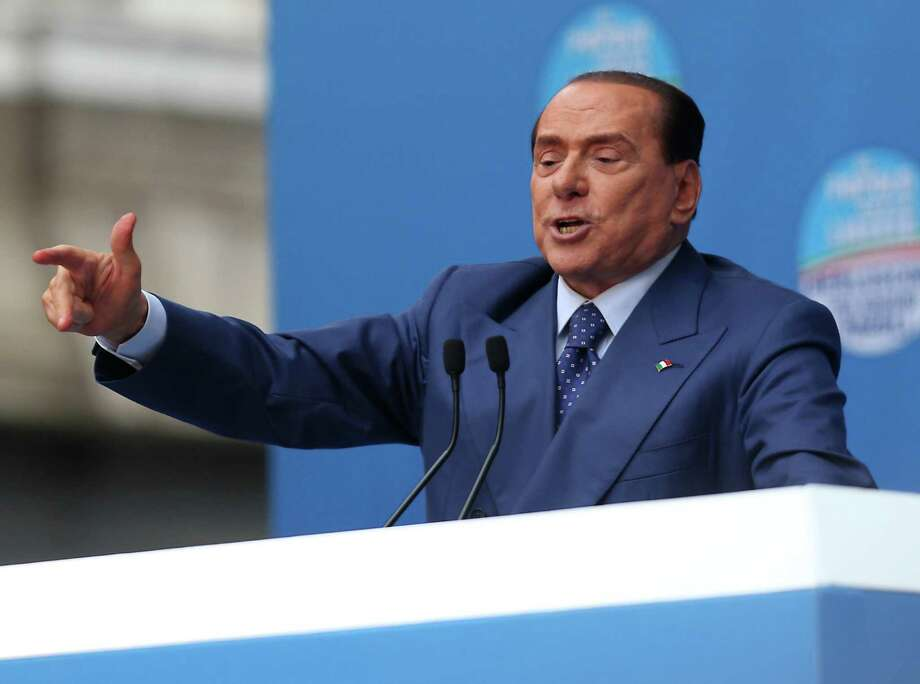 "Silvio Berlusconi speaks at a rally in Brescia, Italy, Saturday, May 11, 2013. Thousands of supporters of former Premier Silvio Berlusconi rallied in a northern Italian city Saturday to protest the media mogul's recent conviction by a Milan appeals court for tax fraud, cheering their hero as police in riot gear separated them from jeering opponents. The backers turned out for the ""Everyone for Silvio"" rally in a square outside the cathedral in Brescia, a small industrial city that is a bastion of the conservative leader's political support. As some arrived, waving pro-Berlusconi banners, some detractors shouted ""jail, jail."" Helmeted police holding plastic body shields moved in between the noisy camps to prevent any physical violence. Photo: AP"