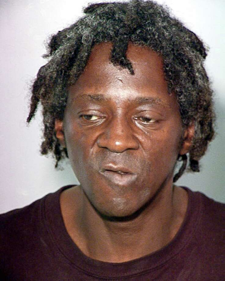 File - This Oct. 17, 2012 file image released by the Las Vegas Police Department shows rapper Flavor Flav, also known as William Jonathan Drayton, Jr., in a police booking photo. Entertainer Flavor�Flav is expected to plead not guilty in Nevada state court to felony charges alleging he chased and threatened his longtime girlfriend's 17-year-old son with a butcher knife during a family argument last October. Photo: AP