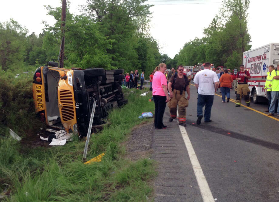 In this photo provided by the Kentucky Transportation Cabinet, emergency crews respond to the scene of an overturned Union County school bus on U.S. 60 at Silver Mine Road near Smithland, Ky., Friday, May 10, 2013. The bus was carrying the Union County High School girls' softball team and had 28 people aboard when it overturned. 25 of those on board were taken to local hospitals with non-life threatening injuries. State Police Trooper Richie Wright said one patient was airlifted from the scene, but it was not due to serious injuries. Photo: AP
