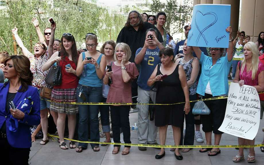 Spectators cheer as the crowd calls out the name of prosecutor Juan Martinez, after a guilty verdict is announced in the murder trial of Jodi Arias, Wednesday, May 8, 2013 in Phoenix. Arias was convicted of first-degree murder Wednesday in the 2008 killing of her one-time boyfriend Travis Alexander after a four-month trial. Photo: AP